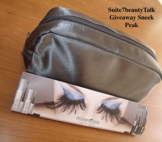 This lovely satin silver makeup case is filled to the brim with makeup goodies, and then there's the jumbo Mirenesse Lip Bomb lip gloss too large to fit inside.